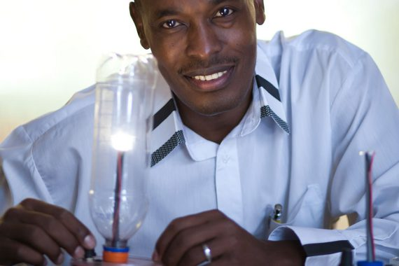 Boniface Njuguna with his solar-powered device.