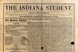 "The image shows a well-worn, slightly damaged image of the front page of the first issue of what would become the Indiana Daily Student. The masthead reads ""The Indiana Student."" Below that, issue and date details are listed, followed by a listing of the terms (single copy, one college year: $1.50), board of trustees, and a lengthy article titled ""How the Indiana Student was named."""