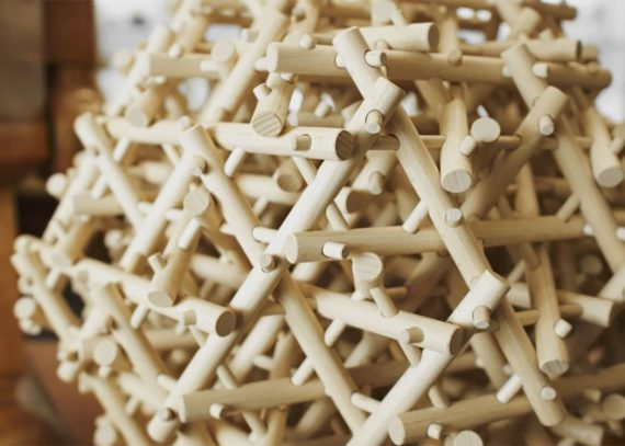 A close-up look at a wooden mechanical puzzle.