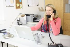 Woman working at home on phone
