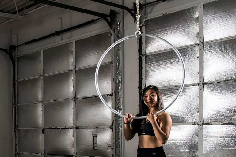 IU student Grace Wang demonstrates the lyra, which is also known as an aerial hoop. It is suspended from above and can be used static or while it's spinning and swinging. Photo by Marc Lebryk.