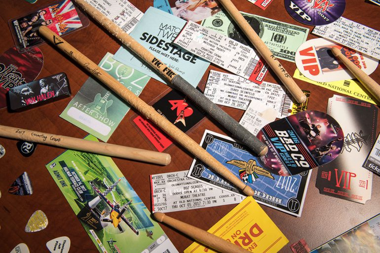 Because he buys tickets close to the stage, Ross Fazekas has a large collection of musicians' set lists, drum sticks, and picks thrown from the stage. Photo by Marc Lebryk.