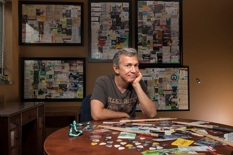 Ross Fazekas keeps all of his ticket stubs together and fills poster-size frames. Once a frame is full, he hangs it on the wall of his office. Fazekas has amassed so many music, comedy, and sports ticket stubs, he is not sure of the exact number. He thinks he has around 1,000 stubs framed. Each one is a happy memory, with its own unique story or experience. Photo by Marc Lebryk.