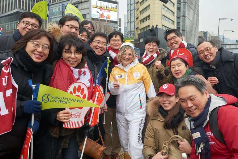 Kesner poses with IU alums and fans who lined the streets in Seoul to see the torch relay.