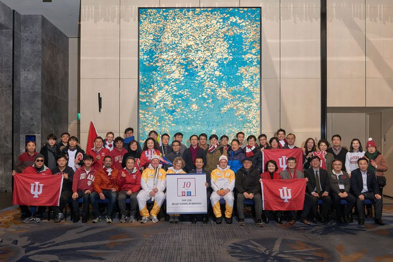 Members of the Korea Chapter of the IU Alumni Association, which is one of the largest IU alumni groups in the world, celebrate with the three torch bearers.