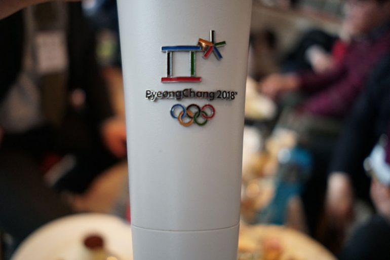 A close-up of the 2018 PyeongChang Winter Olympics torch.