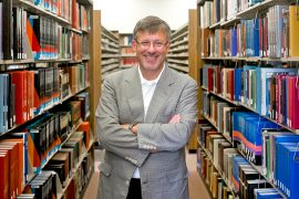 Michael Adams portrait in library