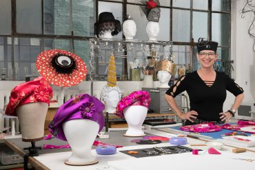 Jodie Bailey in her studio surrounded by her work.