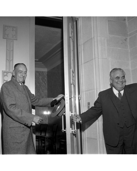 J.K. Lilly and Herman B Wells open the door of the newly dedicated Lilly Library on October 3, 1960.