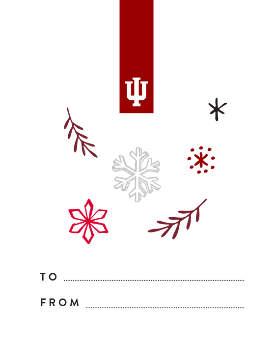 "A gift tag with an IU inspired design: a white trident in a crimson tab at the top, as well as snowflakes and branches in shades of red and limestone. At the bottom, there is a blank ""To"" line and a blank ""From"" line."