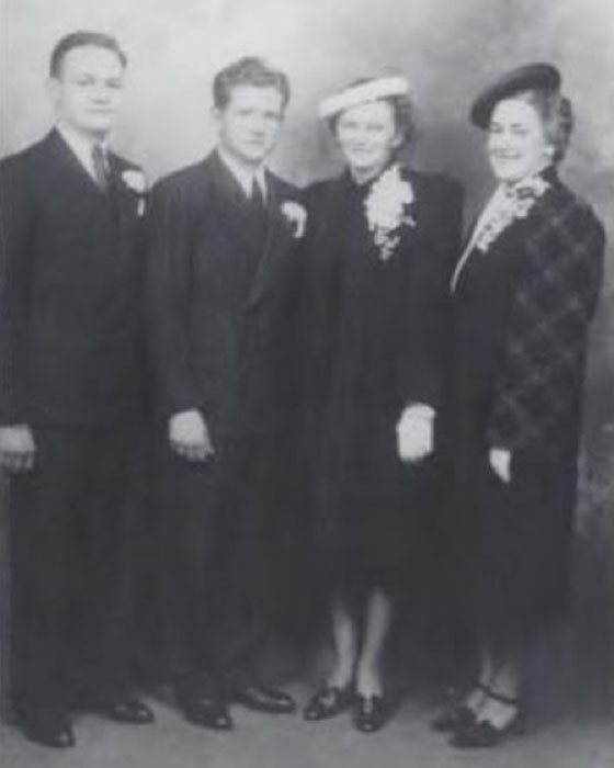Otis and Beth Bowen on their wedding day in 1939, accompanied by the best man and maid of honor.