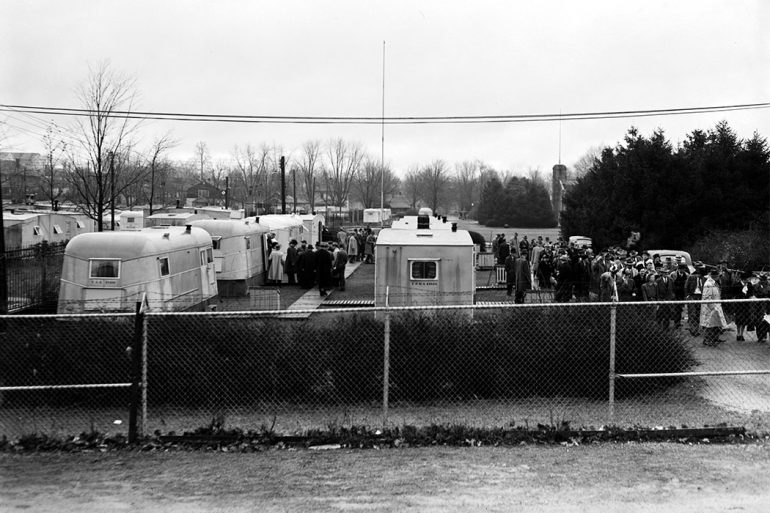 Residents gather around the Woodlawn Court trailer town on November 10, 1946.