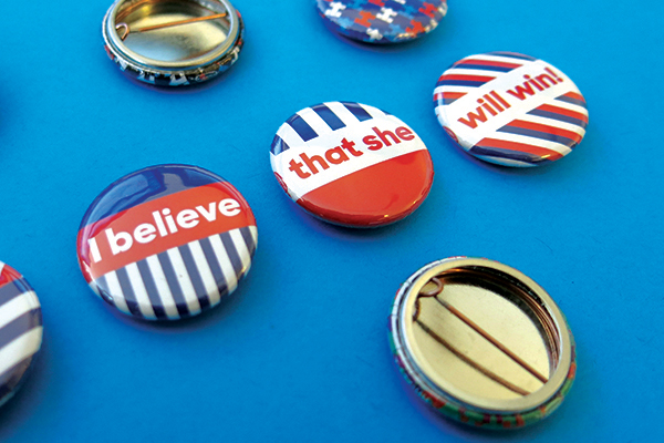 """Red, white, and blue buttons that say """"I believe that she will win!"""""""