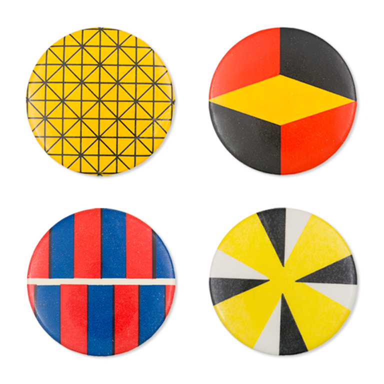 Four multi-colored buttons with geometric designs