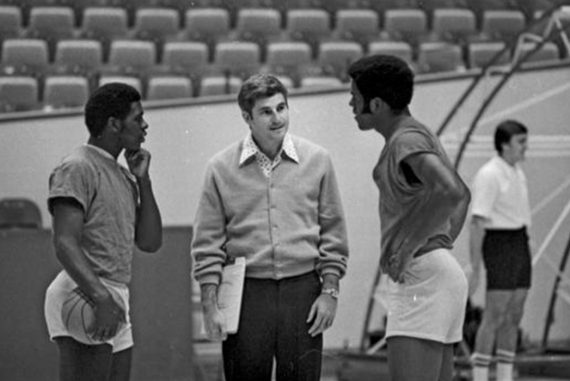 Bob Knight standing with two basketball players