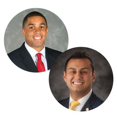 Two portraits inset into one image. The portrait on the left features a smiling man with medium-brown skin and short, dark hair wearing a black suit with a red tie. The portrait on the right features a smiling man with light-brown skin and short, dark hair wearing a black suit with a gold tie.