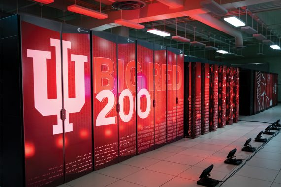 """""""Big Red 200"""" is emblazoned in huge letters on the front of a set of vertical cabinets stacked side-by-side in a room stretching the length of the photo and out of frame."""
