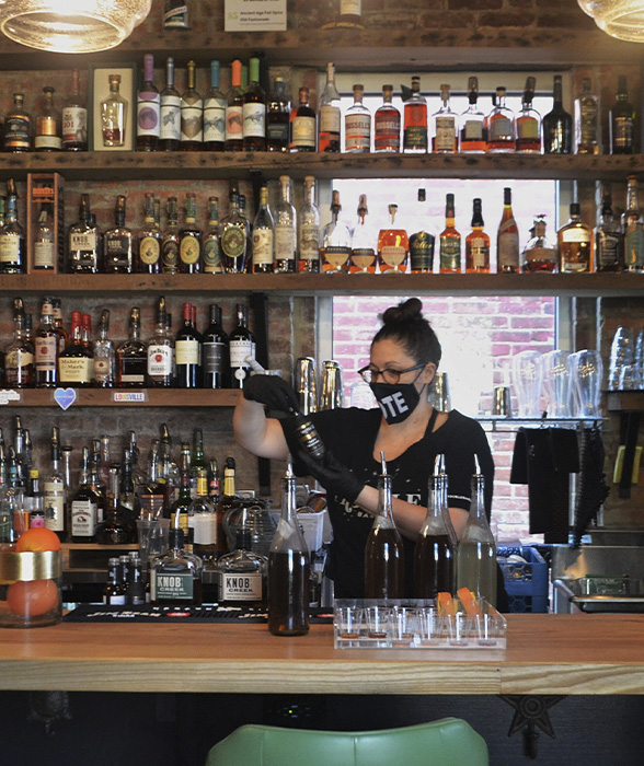 Nicole Stipp pours drink behind bar