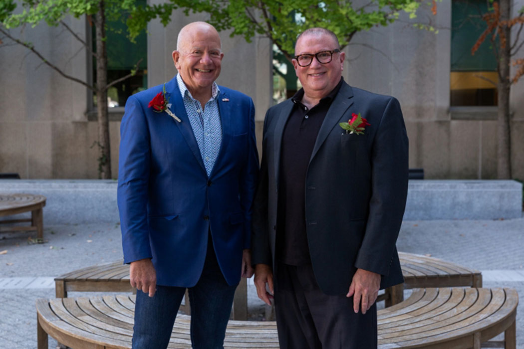 Steve Tuchman and husband Reed Bobrick wear suits