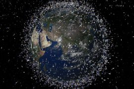 An illustration of planet Earth seen from space, surrounded by the innumerable satellites in its orbit.